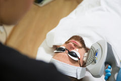 Men`s anti-aging laser therapy Royalty Free Stock Image