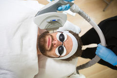 Men`s anti-aging laser therapy Royalty Free Stock Photography