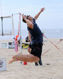 Men's beach volleyball jump serve Stock Photo