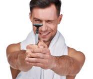 Men`s beauty. Handsome man shaving stock photography