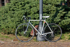 Men`s Bicycle against a Metal Pole royalty free stock photo