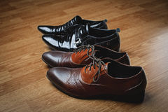 Men's black and brown shoes Royalty Free Stock Image