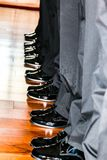 Men`s Black Dress Shoes in a Row Stock Photo