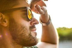 Men's Black Framed Sunglasses Shined by the Bright Sun Stock Photos