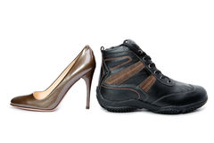 Mens boots and elegant female shoes Royalty Free Stock Image
