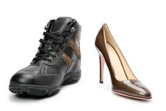 Mens boots and elegant female shoes Royalty Free Stock Images