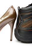 Men s boots and elegant female shoes Royalty Free Stock Image