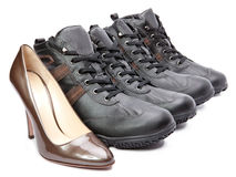 Men's boots and elegant female shoes Stock Images