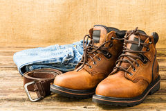 Men's boots, jeans and belt Royalty Free Stock Images
