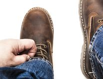 Men`s brown boots and blue jeans isolated. Men`s brown boots and blue jeans. Isolated on white bacground royalty free stock image