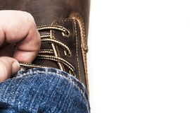 Men`s brown boots and blue jeans isolated. Men`s brown boots and blue jeans. Isolated on white bacground royalty free stock photo