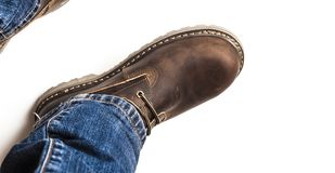 Men`s brown boots and blue jeans isolated. Men`s brown boots and blue jeans. Isolated on white bacground stock photo