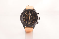 Men's brown leather wrist watch. Brown suede leather wrist watch with black face. White background. Suitable for e-commerce website or graphic design royalty free stock photo