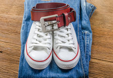 Men's casual jeans and brown leather belt with leather shoe Royalty Free Stock Image