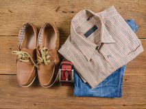 Men's casual jeans and brown leather belt with leather shoe. On wooden board Stock Photo