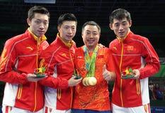 Men`s China team gold medal at the Olympic Games 2016. Women`s China team Xu Xin, Ma Long, Zhang Jhike gold medal at the Olympic Games 2016.Olympic Games. Rio Stock Image