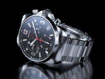 Men`s chrome wristwatch on black background Stock Photos