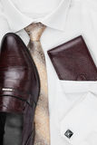 Men's classic accessories: shirt, tie, shoes, as a backdrop. Top view Stock Photo