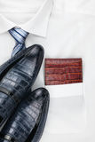 Men's classic accessories: shirt, tie, shoes, as a backdrop. Top view Royalty Free Stock Photo
