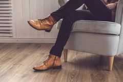 Men`s classic brown shoes. Vintage shoes at the studio Royalty Free Stock Photos