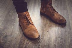 Men`s classic brown shoes. Vintage shoes at the studio Stock Photos