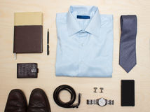 Men's classic outfit with blue shirt, tie and accessories. Men's classic office outfit with blue shirt, tie and accessories Royalty Free Stock Photography