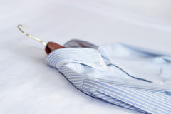 Men's classic shirts on the bed. Shallow depth of field Stock Photo