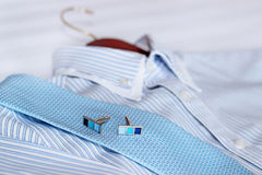 Men's classic shirts on the bed. Shallow depth of field Royalty Free Stock Photo