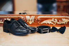 Men's classic shoes, belt, butterfly Royalty Free Stock Photography