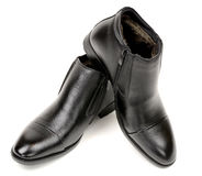 Men`s classic winter boots on a white background. Warm leather shoes Stock Image
