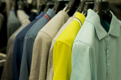 Men's clothes on hangers. Royalty Free Stock Images
