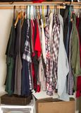 Clothes in closet. Men's clothes hanging in closet stock photography