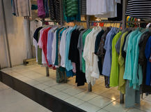 Men`s clothes hanging on the rack display photo taken in Jakarta Indonesia stock photo
