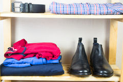 Men's clothes on the shelf Royalty Free Stock Image