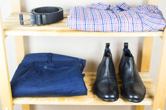 Men's clothes on the shelf Royalty Free Stock Photo