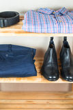 Men's clothes on the shelf Stock Photos