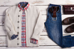 Men's clothing and accessories. Set of stylish winter men's clothing on a wooden background. Men's clothing and accessories Royalty Free Stock Images