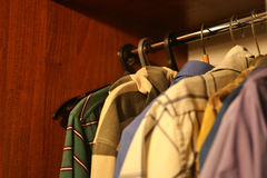 Men`s clothing in the closet. Men`s summer clothes in the closet Stock Image