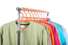 Men's clothing on a hanger, white background. Royalty Free Stock Photo