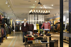 Men's clothing store. Interior view of men's  fashion shop,Hongkong,China,Asia. decorated with pendant lamp and led light Royalty Free Stock Images