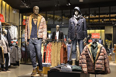 Men's clothing store. Male mannequins wearing jacket and jeans in a fashion shop,Hongkong,China,Asia Stock Images