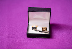 Men's cufflinks in the box on purple fabric Royalty Free Stock Image
