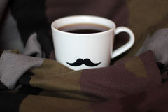 Men`s cup with mustaches on a background military February 23. Card Stock Photos