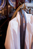 Men's dress shirt and tie. Shirt and Tie hanging on a hanger Royalty Free Stock Photo