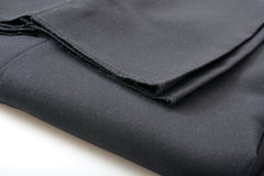 Men's dress slacks. A folded pair of un-hemmed men's dress slacks closeup Royalty Free Stock Photo