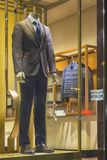 Men`s dummy in a suit in a show-window of shop. Sale Stock Images