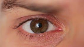 Men's eye closeup stock video footage
