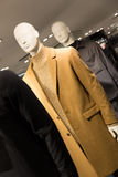 Men`s fashion - mannequins dressed in coats in a clothes store Stock Images