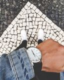 Men& x27;s fashion watch with demin royalty free stock photo