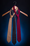 Men's fashionable ties on a hanger. Royalty Free Stock Images